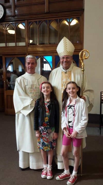 Archbishop Malcolm with Donagh and children.